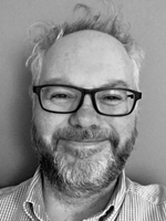 A black and white portrait of Pete Massey